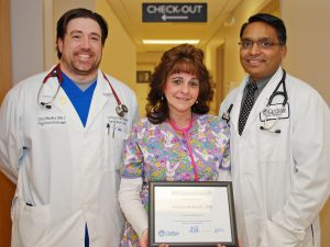 """From left: Christopher Mueller, P.A., primary care physician assistant, Patricia """"Patty"""" Bischoff, LPN, primary care nurse, and Dr. Hardik I. Patel, M.D., primary care physician."""