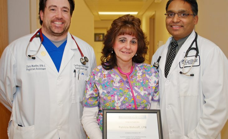 "From left: Christopher Mueller, P.A., primary care physician assistant, Patricia ""Patty"" Bischoff, LPN, primary care nurse, and Dr. Hardik I. Patel, M.D., primary care physician."