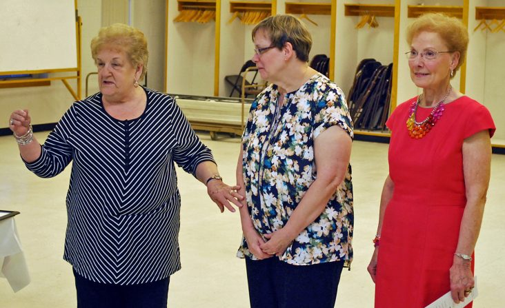 """From left, Carthage Area Hospital Auxiliary member Ann Hancock introduces Michel Camidge, center, as the auxiliary """"Senior Volunteer"""" award recipient while Yolanda Skvorak, Carthage Area Hospital Auxiliary interim president, looks on."""