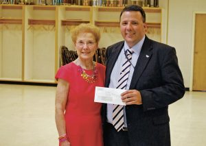 From left, Yolanda Skvorak, Carthage Area Hospital Auxiliary interim president, presents hospital CEO Rich Duvall with a $6,000 donation. The money will help the hospital pay for additional patient transport wheelchairs for use in hospital.